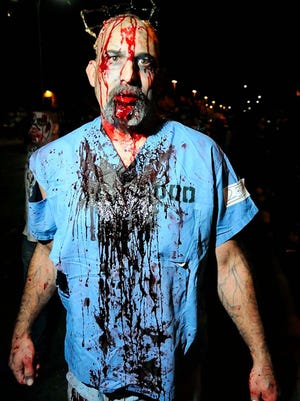 Jim Fulkerson participates in the last year's Zombie Walk. The 2015 walk is from 6 to 10 p.m. on downtown Main Street, in Las Cruces.