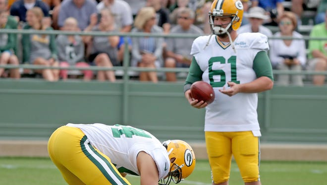 Green Bay Packers long snapper Brett Goode (61) watches as long snapper Derek Hart (54) prepares to snap the ball during training camp Wednesday, August 23, 2017 at Ray Nitschke Field in Ashwaubenon, Wis.