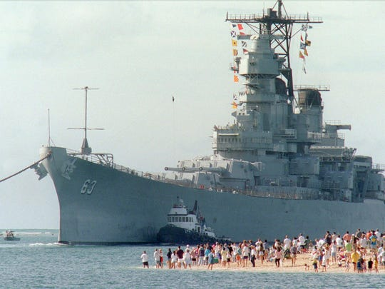 """The battleship USS Missouri, """"Mighty Mo"""" looms over a huge crowd as it returns to Pearl Harbor on Monday, June 22, 1998, to be used as a museum near the Arizona Memorial."""