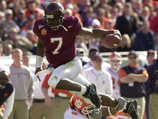 Virginia Tech quarterback Michael Vick (7) eludes Clemson's