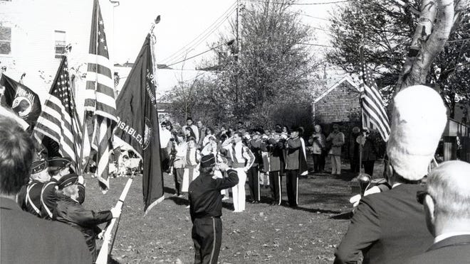 Veterans Day observances on the Hyannis Village Green in 1989 included a playing of the National Anthem by the Barnstable High School Marching Band.