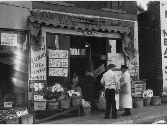 Men standing in front of store, 1935. Farm Security Administration.