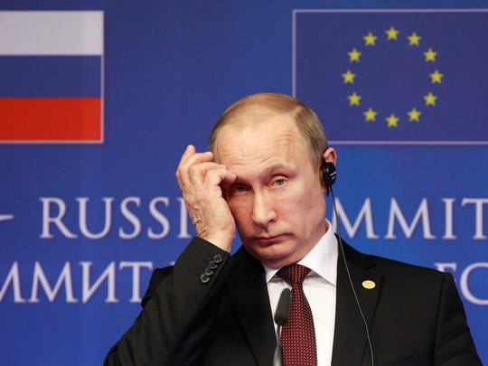 FILE - In this Jan. 28, 2014 file photo, Russian President Vladimir Putin addresses the media at the end of an EU-Russia summit, at the European Council building in Brussels.  (AP Photo/Yves Logghe, File)