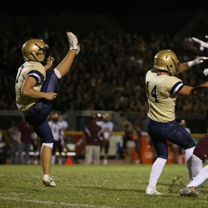 Desert Vista's Kyle Ostendorp (7) punts against Mountain