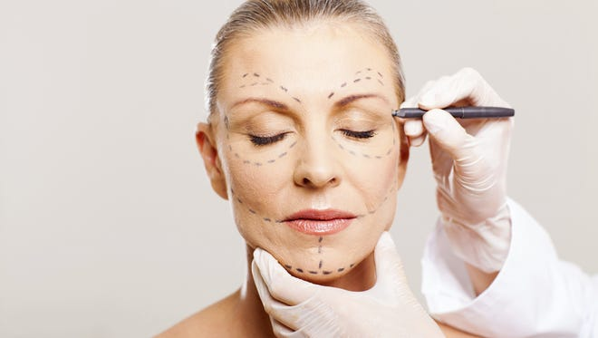 Stock Photo: Woman with correction lines.