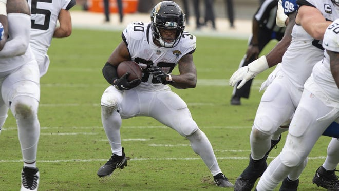 Jacksonville Jaguars running back James Robinson (30), a former Rockford Lutheran star, set an NFL record for most rushing yards by an undrafted rookie in Week 1. He helped the Jaguars win the season opener 27-20 Sunday against the Colts at TIAA Bank Field in Jacksonville, Florida.