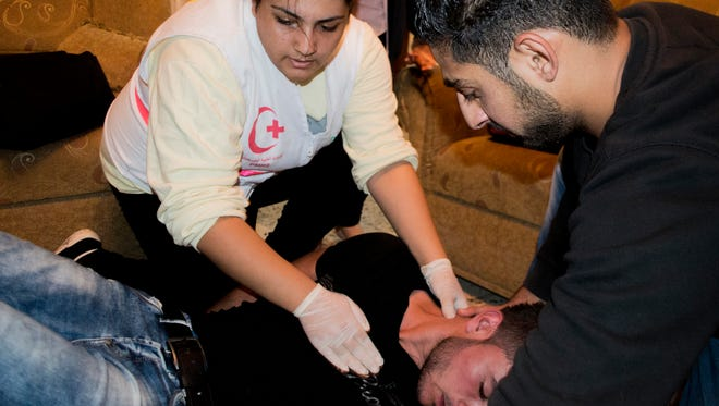 Lara Ramadan, 24, travels from miles away to volunteer her time as a medic during clashes in Bethlehem, West Bank.