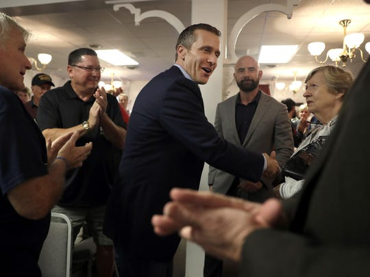 Missouri Republican gubernatorial candidate Eric Greitens shakes hands with supporters during a campaign stop Wednesday in Kirkwood.