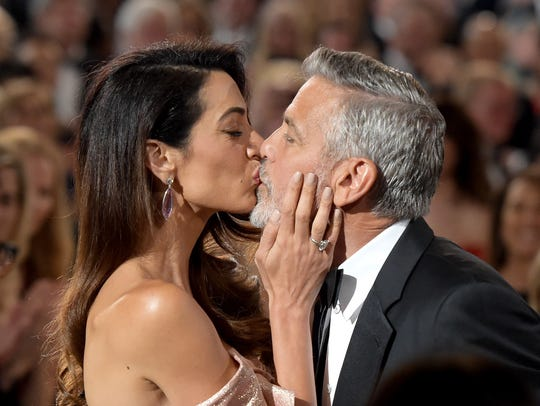 Amal Clooney kisses husband George during his AFI Lifetime Achievement award dinner on June 7.