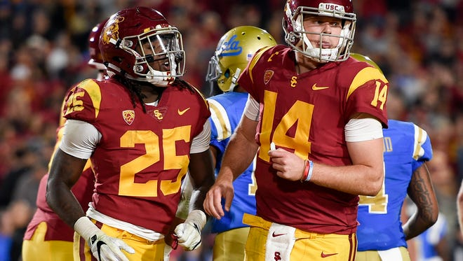 Nov 18, 2017; Los Angeles, CA, USA; Southern California Trojans running back Ronald Jones II (25) celebrates with quarterback Sam Darnold (14) after scoring a touchdown against the UCLA Bruins during the second half at Los Angeles Memorial Coliseum. USC won 28-23.