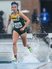 North Dakota State's Maddie Van Beek negotiates the water hazard on the way to winning the women's 3000 steeplechase Sat. April 25, 2015 at the Drake Relays in Des Moines, Iowa.