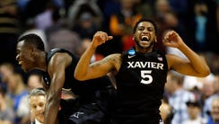 Xavier Musketeers guard Malcolm Bernard (left) and