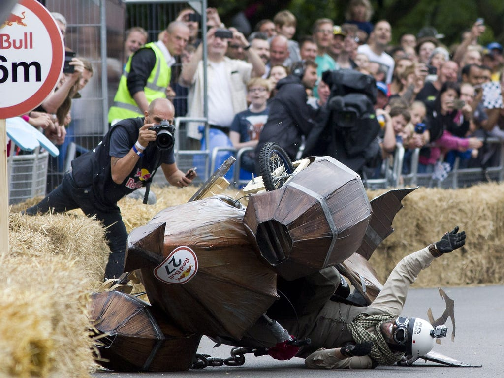 A team crashes into hay bales in the Red Bull Soapbox race in London. The Red Bull Soapbox race is an annual event in which amateur drivers race with their homemade soapbox vehicles down a hill through obstacles.