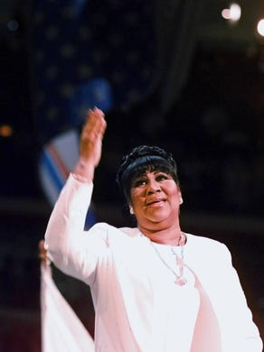 Aretha Franklin acknowledges applause after her rendition