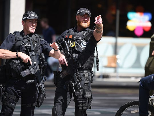 Police stand guard near the Manchester Arena on May