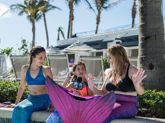 As part of her wish from the Make-A-Wish Foundation, Anna Kuhn  (center), of Springettsbury Township, had the opportunity to interview mermaids for a local TV station in Florida.