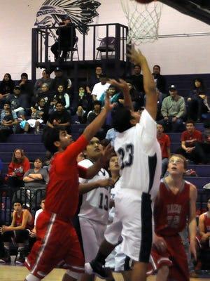 Larian Hosetosavit takes the ball to the basket for Mescalero Apache School against Carrizozo High Dec. 8.