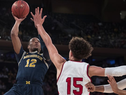 Michigan guard Muhammad-Ali Abdur-Rahkman (12) goes to the basket against Nebraska forward Isaiah Roby (15) during the first half of an NCAA college basketball game in the quarterfinals of the Big Ten conference tournament, Friday, March 2, 2018, at Madison Square Garden in New York. (AP Photo/Mary Altaffer)