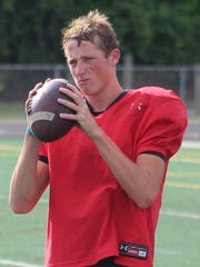 Senior Colton Tinsley takes over at quarterback this year for Groves after serving as Beau Kewley's backup last year.