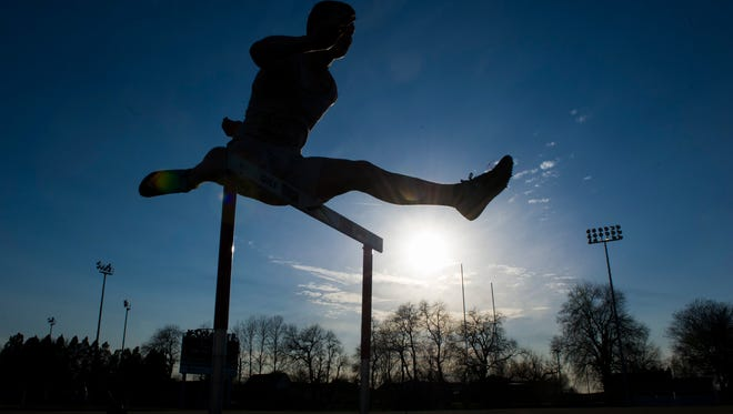 Adrian Kjellen, 17, of Nykšping, Sweden, jumps hurdles during track practice at Henderson County High School, Wednesday, March 8, 2017. Kjellen is an exchange student currently living with the Troutman family in Henderson.