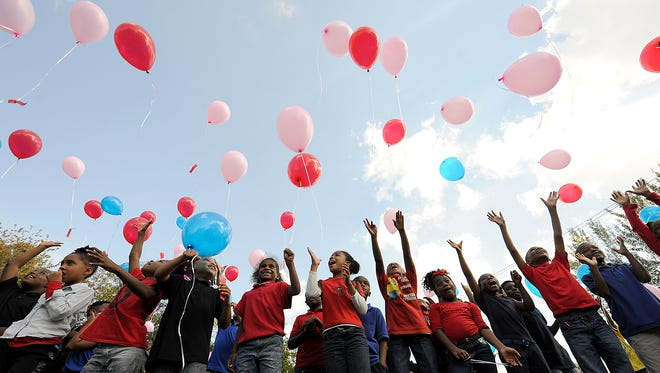 Students release balloons in the lot next to Lincoln Elementary School in Jackson, Tenn., on Friday, Oct. 28, 2016.