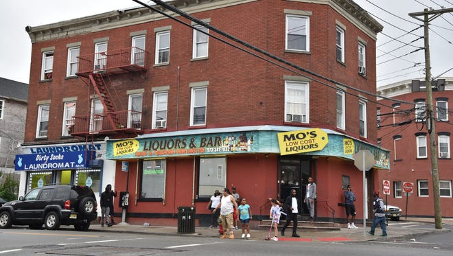Mo's Liquor store at the corner of Main and Weiss streets in Paterson. The Paterson Alcoholic Beverage Control board last July handed down a 200-day suspension based on seven violations, including two drug-involved offenses. Under a new deal, the suspension was reduced to 60 days.
