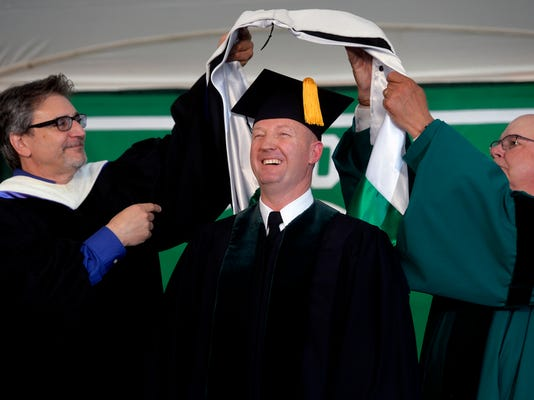 Brigadier Gen. Kurt Ryan, who graduated from York College in 1987, receives an honorary doctorate of humane letters during York College's commencement ceremony on Saturday, May 16, 2015. York College graduated 749 students in its spring ceremony. Chris Dunn Ñ Daily Record/Sunday News