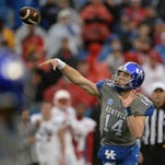 UK QB Patrick Towles throws during the University of Kentucky football game against University of Louisville at Commonwealth Stadium in Lexington, Ky., on Saturday, November 28, 2015.  Photo by Mike Weaver