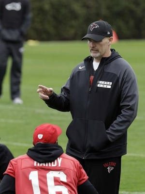 Atlanta Falcons head coach Dan Quinn talks with wide receiver Justin Hardy (16) during a practice for the NFL Super Bowl 51 football game Friday, Feb. 3, 2017, in Houston. Atlanta will face the New England Patriots in the Super Bowl Sunday. (AP Photo/Eric Gay)