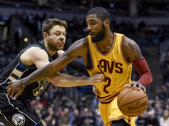Dec 20, 2016; Milwaukee, WI, USA;  Cleveland Cavaliers guard Kyrie Irving (2) drives for the basket against Milwaukee Bucks guard Matthew Dellavedova (8) in the first quarter at BMO Harris Bradley Center. Mandatory Credit: Benny Sieu-USA TODAY Sports