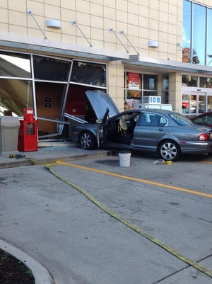 Store employees at Tim Hortons say it appeared the driver panicked and accelerated when he drove into the building.