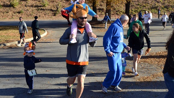 Runners take part in a past Jus' Running Turkey Trot