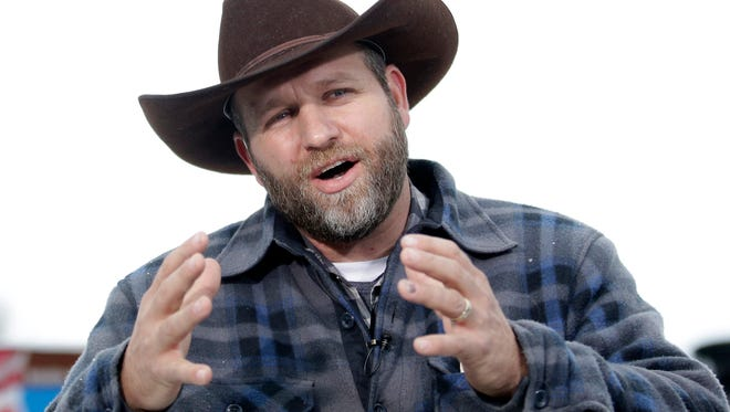 In a Tuesday, Jan. 5, 2016 file photo, Ammon Bundy speaks during an interview at Malheur National Wildlife Refuge, near Burns, Ore. Authorities said Tuesday, Jan. 26, 2016, that Bundy, leader of the armed Oregon group, has been arrested. Authorities say shots were fired during the arrest of members of an armed group that has occupied a national wildlife refuge in Oregon for more than three weeks. The FBI said authorities arrested Ammon Bundy, 40, his brother Ryan Bundy, 43, Brian Cavalier, 44, Shawna Cox, 59, and Ryan Payne, 32, during a traffic stop on U.S. Highway 395 Tuesday afternoon.