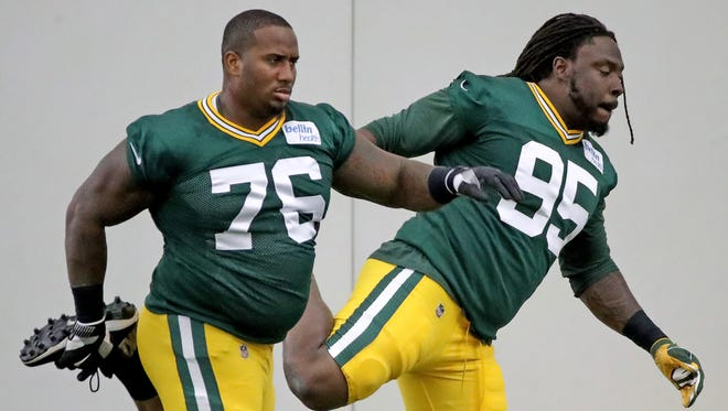 Green Bay Packers defensive end Mike Daniels (76) and defensive tackle Ricky Jean Francois (95) stretch during practice Sept. 6, 2017 inside the Hutson Center.