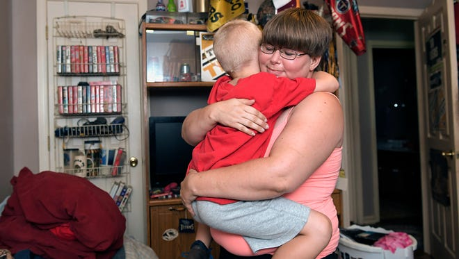 Tasha Burrage hugs her son, Bryson Hines, 5, after helping him change his clothes at their home near Smithville on Thursday, July 19, 2018. Burrage and her children are part of a pilot program between Youth Villages and the Department of Children's Services to help children avoid foster care.