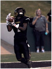 Abilene High School wide receiver Raekwon Millsap catches