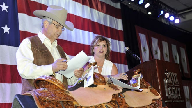 Perry Di Loreto, left, at the Reno Rodeo Invitational Team Roping banquet in 2014.