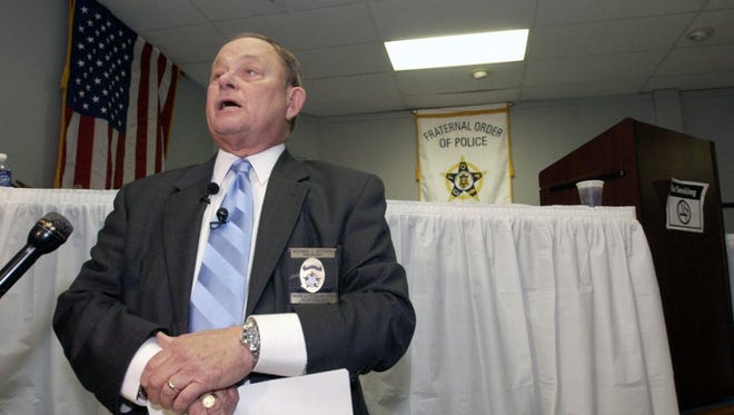 Seen in this file photo, Richard Dotson speaks in 2004 as president of the local Fraternal Order of Police. He also served as chief of the Louisville Division of Police for eight years.