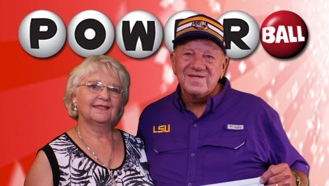 Glenn Feazell of Boyce is shown with his wife, Mary, after claiming a $1 million Powerball prize.