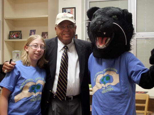 "Brianne Nickol, legendary high school coach Herman Boone and the Central Panther mascot pose in 2011. Boone had a movie, ""Remember the Titans,"" based on his life as the football coach at T.C. Williams in Virginia."