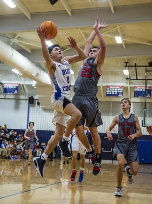 Asheboro'sNoah Watkins, shown here in action against Wheatmore last season, scored 26 points in the Blue Comets' 63-49 win over Southern Alamance on Tuesday. [PJ Ward-Brown for The Courier-Tribune]