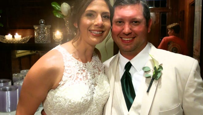 Bride Claire Harrington and groom Brandon Mayeaux at their Atahoe Plantation wedding reception.