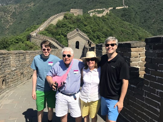 Visiting Slater Rhea (far right) last summer at the Great Wall of China were, (from left) his brother Jonathan and parents Milton and Sue Rhea of Alexandria. Slater has become a popular singer and television personality known as Shuaide in China.