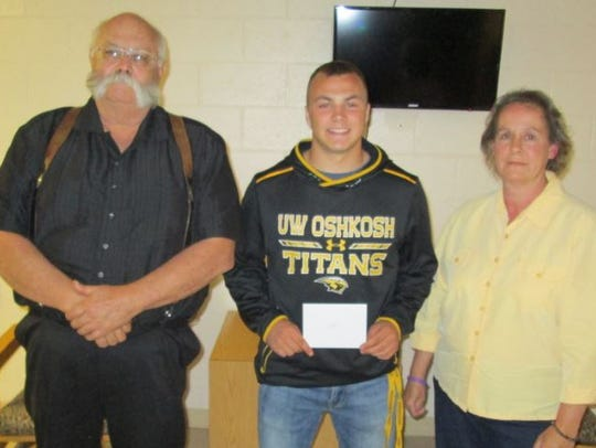 Jack Ribley, center, of Francis Creek receives the