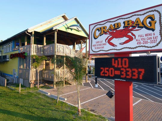 The Crab Bag offers happy hour all day, seven days a week.