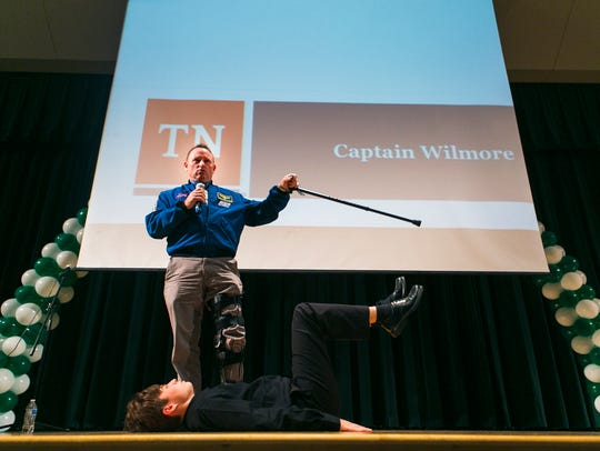 October 27, 2016 - Capt. Barry Wilmore, NASA astronaut and United States Navy test pilot, talks to an audience of students as junior James Potts, 16, demonstrates how Wilmore sits in a space shuttle during a visit to White Station Middle School.