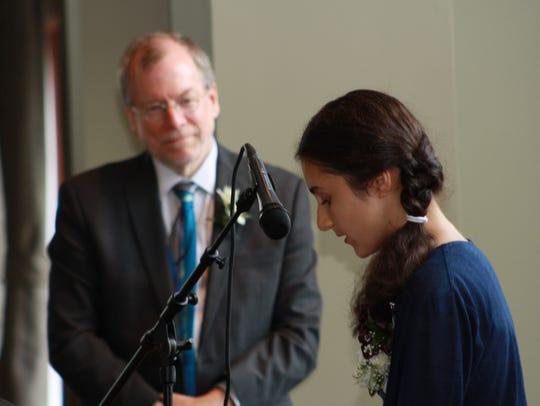 Maya Rai honors her teacher, John Kennedy.