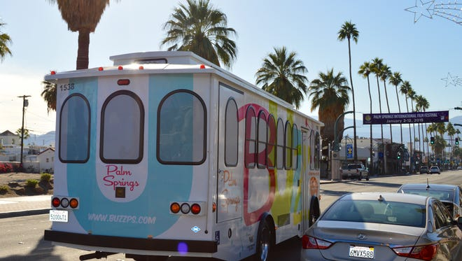 The Buzz trolley heads through downtown Palm Springs in December 2014.