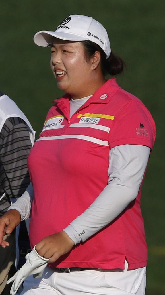 Today's leader Shanshan Feng after sinking a birdie