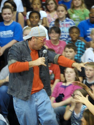 """During his time as Bend Gate Elementary School principal, Steve Steiner entertains a crowd of students at North Middle School as Kanye North during an """"American Idol"""" competition held as part of a rally in preparation for state testing."""